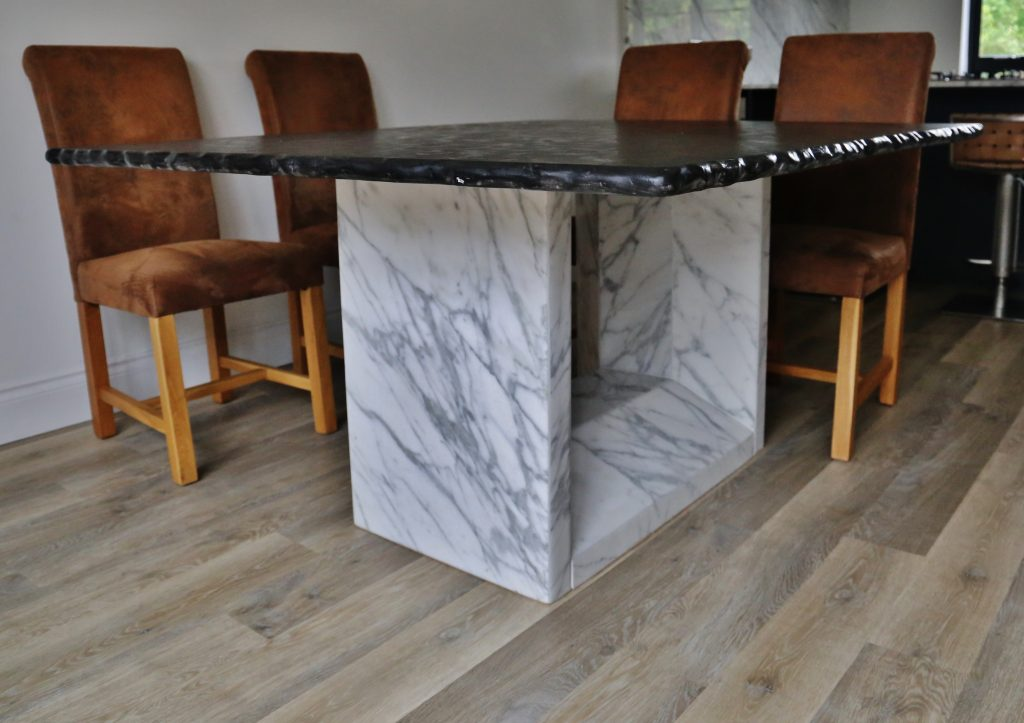 Granite table in Leather finish Matrix, table base in Calacatta Marble.