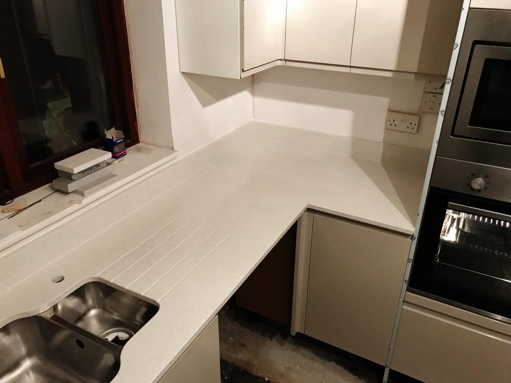 White Mirror Chip 2cm quartz stone worktops and up-stands